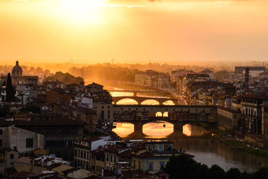 woman with cup of Mokarico's coffee at Ponte Vecchio Florence